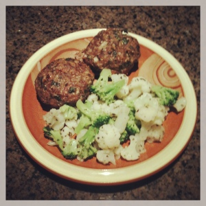 Lamb meatloaf muffins served with broccoli and cauliflower seasoned with Greek herbs and garlic.